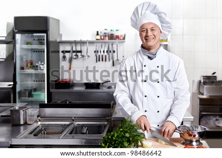 Cook cut vegetables in the kitchen - stock photo