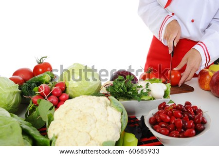 Cook cuts the vegetables. Isolated on white background - stock photo