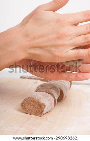cook hands preparing dough on the table