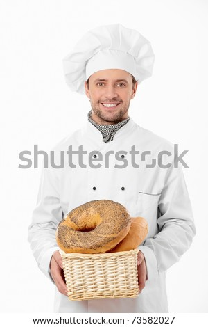 Cook holds a basket of bread on a white background