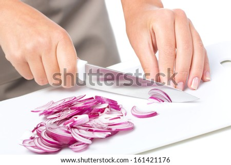 Cook is chopping onion, closeup shoot