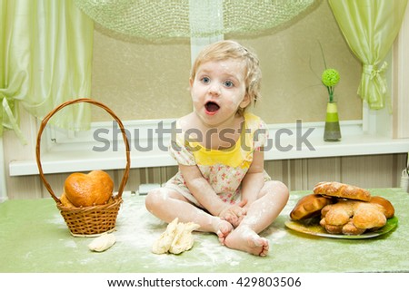 Cook - little girl on kitchen kneads dough, roll a rolling pin and bakes muffins and cakes, fun and hooligans