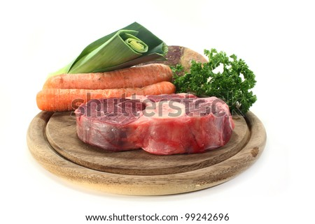 Cook meat and soup vegetables on a wooden board - stock photo