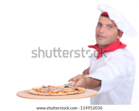 Cook serving pizza - stock photo