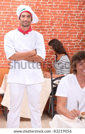Cook standing in a restaurant - stock photo