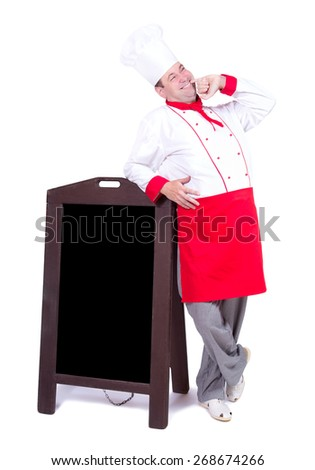 cook standing with an blank menu - stock photo