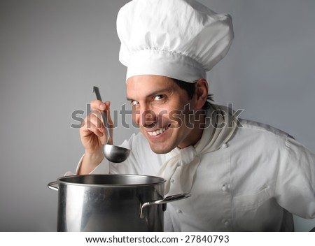 cook tasting food - stock photo