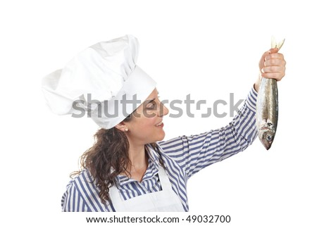 Cook woman holding a fresh fish isolated on white background - stock photo