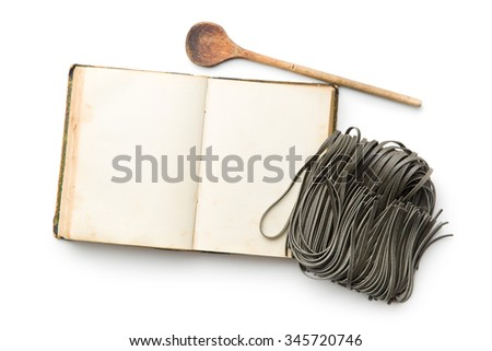 cookbook and black noodles with squid sepia ink on white background - stock photo