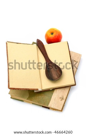 Cookbooks, apple and spoon isolated on white background. Place for your recipe - stock photo