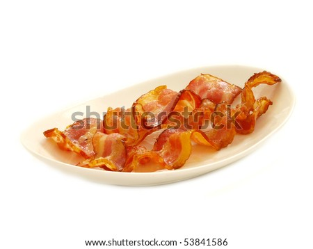 cooked bacon in plate isolated - stock photo