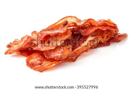Cooked bacon rashers close-up isolated on a white background. - stock photo
