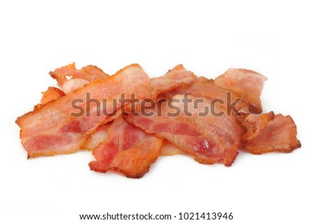 Cooked bacon rashers on a white background