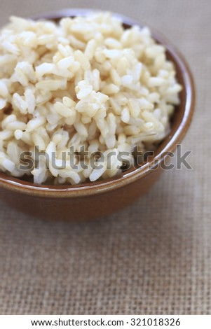cooked brown rice on jute cloth. organic.