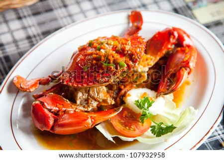 cooked crabs with spicy sauce on white plate (selective Focus)