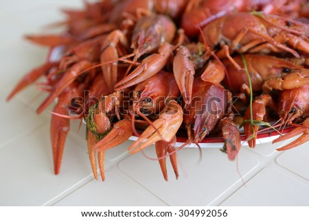 Cooked crayfish on the plate at a restaurant - stock photo