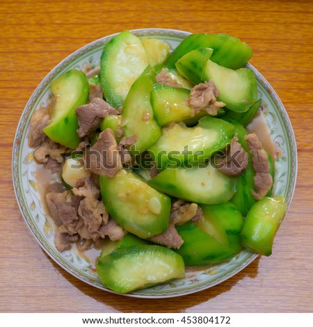 cooked fresh angled loofah with pork on dish ready to eat - stock photo