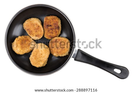 Cooked fried cutlets in pan isolated on white background, top view - stock photo