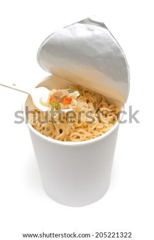 cooked instant cup noodle with ingredient and fork on white background - stock photo