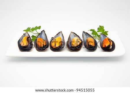 cooked mussels prepared to consume - stock photo