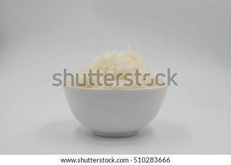 Cooked rice in a bowl on a white background.