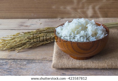cooked rice on wooden background - stock photo