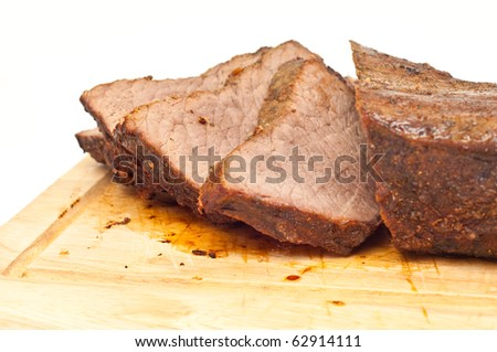 cooked roastbeef on a wooden board isolated - stock photo