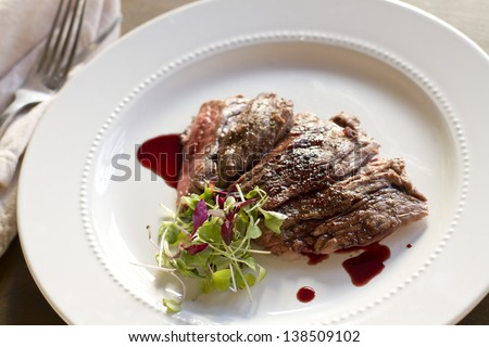 Cooked skirt steak with a pomegranate gastrique. - stock photo