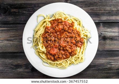 Cooked spaghetti bolognese on white plate. - stock photo