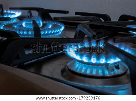 cookers home kitchen with the typical blue flame - stock photo