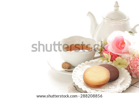 Cookie and english tea with copy space - stock photo