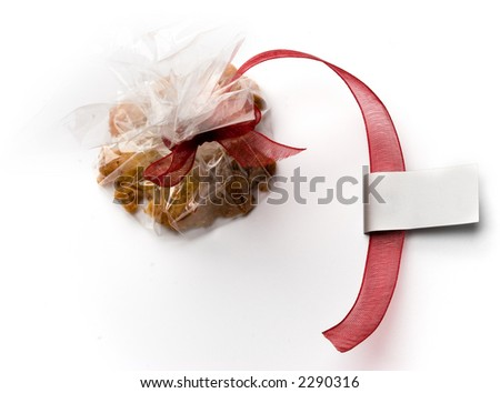 Cookie gift with silver tag, with copyspace, isolated on white - stock photo