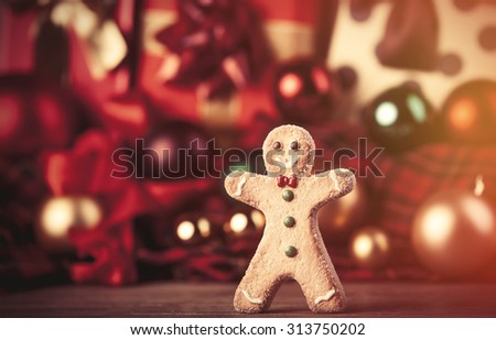 Cookie man and christmas gifts - stock photo