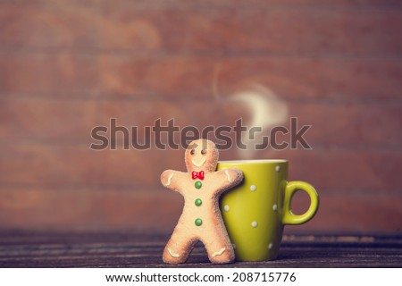Cookie man and cup o hot chocolate. Photo in old color image style. - stock photo