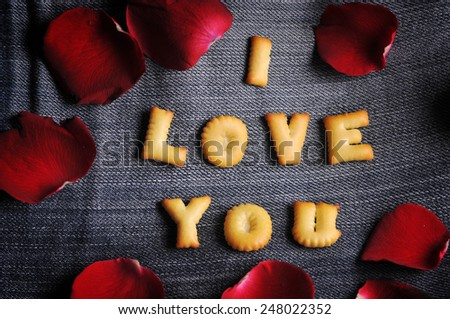 Cookies ABC in the form of word I LOVE YOU alphabet on old jean background, Valentines day - stock photo