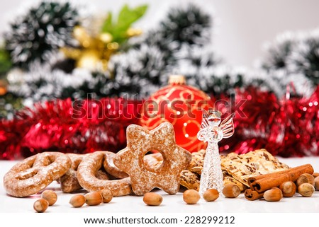 Cookies and decorative glass angel on de-focused christmas theme background