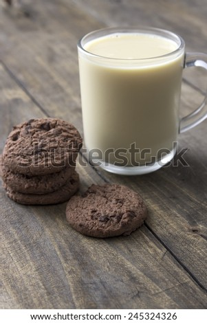 Cookies and milk on wooden table, close up - stock photo