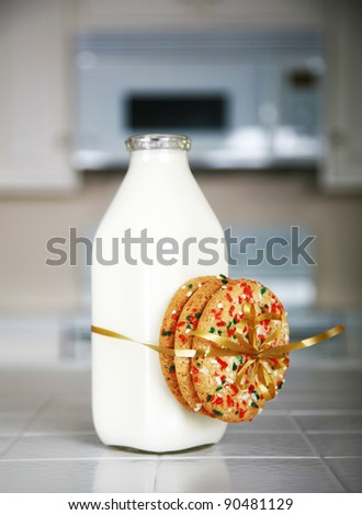 Cookies and Milk with an antique glass milk bottle - stock photo