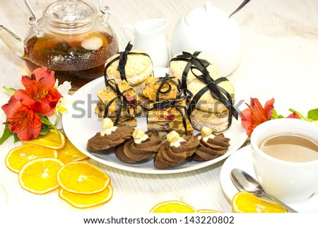 cookies and tea on a table in a restaurant
