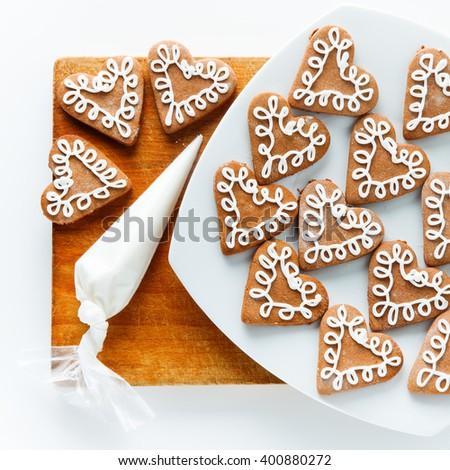 cookies bags of icing on the cookies. drawings of icing on the cookies - stock photo