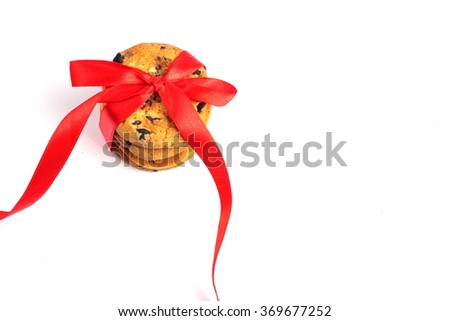 cookies decorated with a red ribbon isolated on a white background