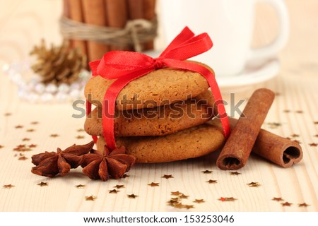 Cookies for Santa: Conceptual image of ginger cookies, milk and christmas decoration on light background - stock photo