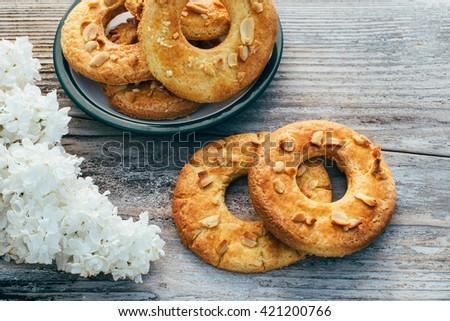 Cookies in the shape of a ring on a wooden background