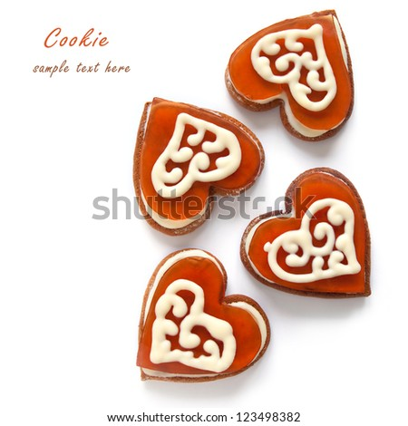 Cookies in the shape of heart with cherry jelly and white chocolate on the white background - stock photo