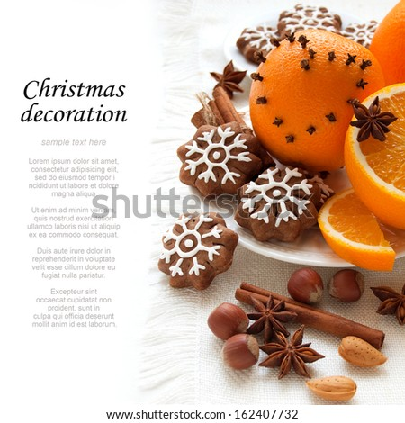 Cookies in the shape of snowflakes with oranges, decoration for Christmas - stock photo