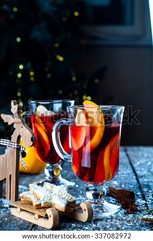 cookies in the shape of stars, spices and mulled wine  - stock photo
