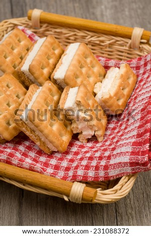 Cookies in the table basket with backing of natural wood - stock photo