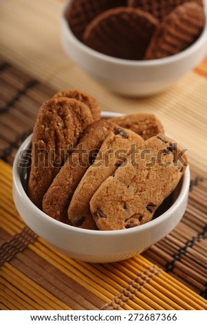 Cookies in white bowl - close-up - stock photo