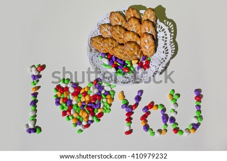 Cookies lies on a white plate,candy lie on plate,colorful candy lie on a white plate, delicious candy lie on plate isolated on white,candy in the form of heart - stock photo