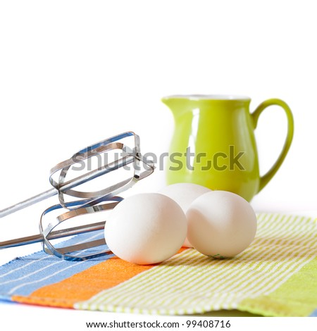 Cookies making: fresh eggs, mixer, green jug with milk isolated - stock photo
